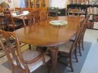 Solid Oak Dining room table-with two leafs 7 ft long