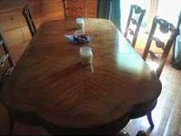 Solid Oak dining room table with 6 chairs. Used only 3
