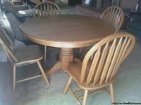 Solid oak dining room table with leaf and 4 chairs $300