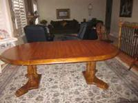 Solid oak dining table with 2 leaves, 8 matching chairs