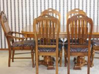 Solid oak dining room table and six chairs, includes