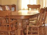 Solid Oak Dinning Table and 6 chairs with 2 captians