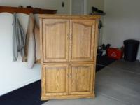 Solid oak entermentainment center mint condition not a