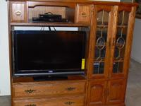 Hello, I am selling a beautiful solid oak entertainment