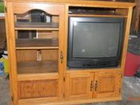 Solid Oak Entertainment Center w/27 in T.V. that works.