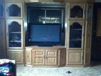 THIS IS A BEAUTIFUL SOLID OAK ENTERTAINMENT CENTER ..