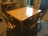 Beautiful wooden dinner table with 6 chairs in very