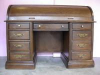 FOR SALE: Nice solid oak roll top desk. The desk is