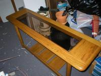 This VERY heavy solid oak sofa table is lovely. It is a