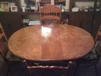 Solid Oak table and 4 chairs with 2 leaves. Like new