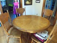 I have a solid light oak table with 4 matching chairs.