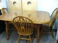 Solid, sturdy oak table and 4 chairs with additional