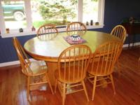 SOLID OAK TBL AND 6 CHAIRS HAS 2 PEDESTALS. IT IS A