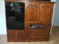 For sale is a used, heavy, solid oak tv / entertainment