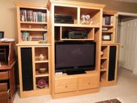 SOLID OAK entertainment center for sale. Retail: $2400