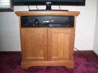 This solid oak TV stand is in great condition and comes
