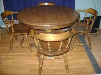 Oak wood table with laminated top. It is heavy and in