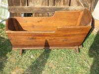 Hello--selling a  solid pine antique cradle--our