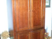 This is a slightly used Armoire made from solid Pine.