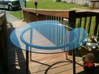 """Solid Round Glass Table: This table measures 41"""" in"""
