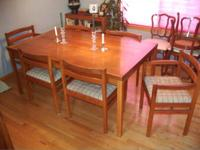 Solid teak dining table and 6 upholstered chairs of