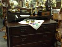 Strong walnut antique dresser. Has mirror. Very