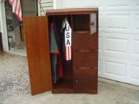 This is a solid wood armoire, in excellent condition..