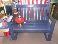 Very sturdy wooden bench that was freshly stained a