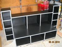 I have a hand made black &silver, solid wood media
