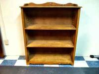 Solid wood bookshelf with adjustable shelves. It was a