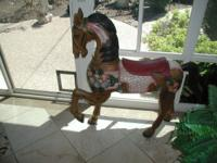 This is a beautiful painted ,sculpted wooden horse. It