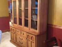 I have a large solid wood china cabinet. I am not sure