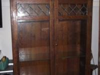 Dark solid wood china cabinet. Glass shelves, glass