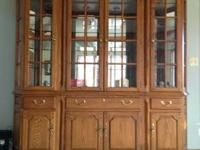 Solid wood curio cabinets for sale in St. Charles. One