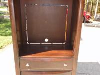 This is solid wood with a dark stain TV hutch with