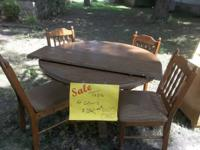 Solid Wood round dining room table with four chairs.