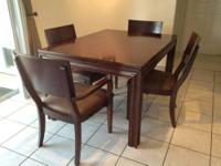 Solid Wood Dining Table with four chairs originally
