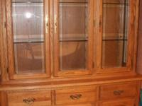 This hutch is solid wood with three shelves in the