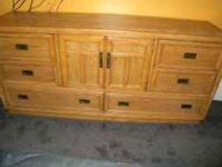 This dresser is solid wood with 8 drawers. Light oak