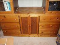 This is a hand-made solid wood entertainment center.