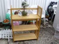 Pretty pine solid wood fold able shelving. Stand