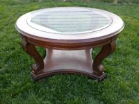 We are selling a round strong wood with glass top