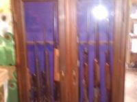 8 gun wood gun cabinet with glass doors. Key locked.