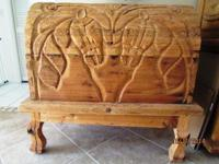 Solid wood hand carved large trunk with wood stand.