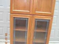 This is a beautiful solid wood kitchen cabinet with