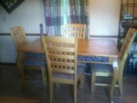 Solid Wood Kitchen Table. It has Rod Iron design. 4