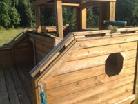We have a Custom Built Solid Treated Wood (Large