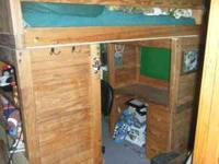 solid wood loft bed in good condition with desk and