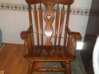 Solid wood maple rocking chair with contoured seat.