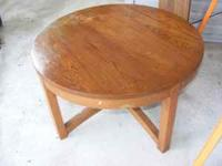 about 3 foot round solid wood coffee table. We believe